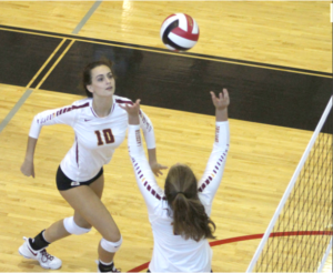 Regan Kitchens sets the ball for Stacia Braner